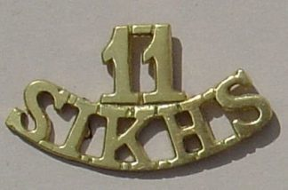 11th SIKHS cast brass shoulder title