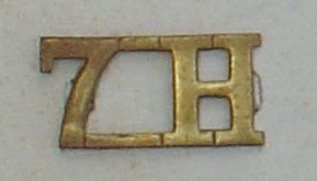 7.H - 7th Hussars brass shoulder title