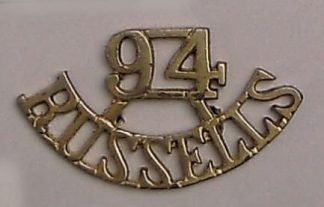 94th RUSSELS curved cast brass  shoulder title