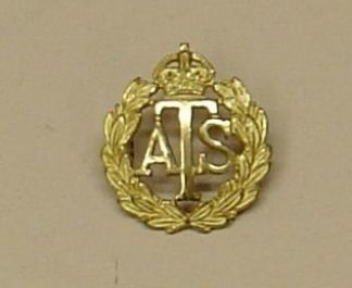 A .T.S., K.C., Officer's gilt cap badge
