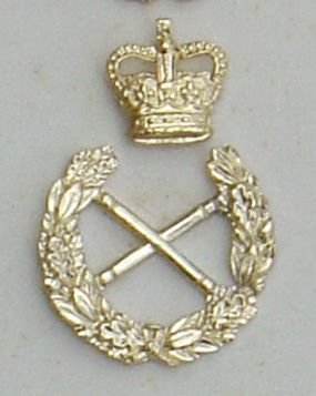 Crossed Batons within Wreath, seperate QC' above