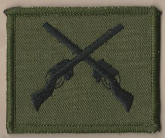 CROSSED RIFLES embroidered black on green patch