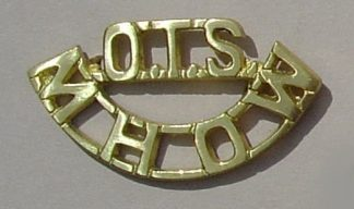 OTS-MHOW cast brass shoulder title