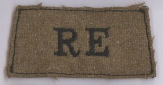 R.E. embroidered black on a light khaki