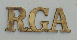 R.G.A. - ROYAL GARRISON ARTILLERY brass shoulder