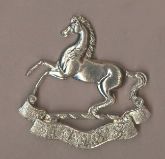 KINGS (LIVERPOOL) REGIMENT white metal or's re-strike cap badge