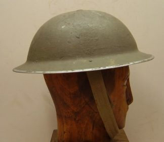BRITISH WWII 'TOMMY' HELMET complete with liner and chin-strap