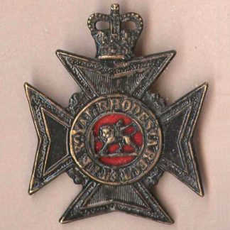 ROYAL RHODESIA REGIMENT QC black cap badge