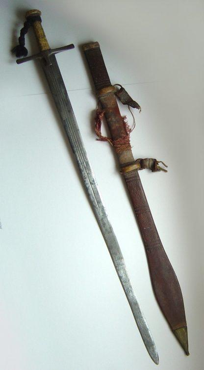 SUDAN - Mahdist period Kaskara complete in leather scabbard.
