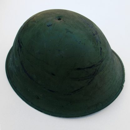 BRITISH 1944 Turtle Pattern Steel Combat Helmet complete with liner and elasticated chin-strap.