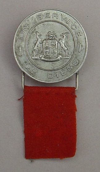 The SOUTH AFRICA WWII for 'On Service' - DISCHARGED SERVICEMAN BADGE -  nickel with 'orange' cloth tag