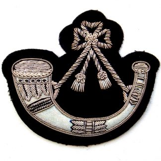 Light Infantry Silver bullion embroidered on black.